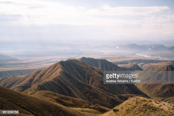 scenic view of mountains against cloudy sky - bishkek stock pictures, royalty-free photos & images