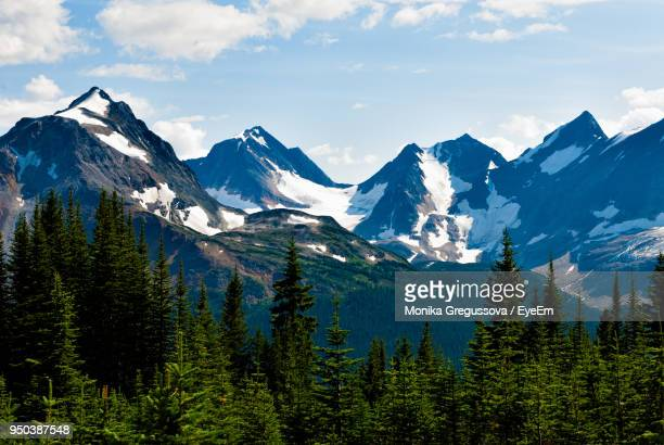 scenic view of mountains against cloudy sky - monika gregussova stock pictures, royalty-free photos & images