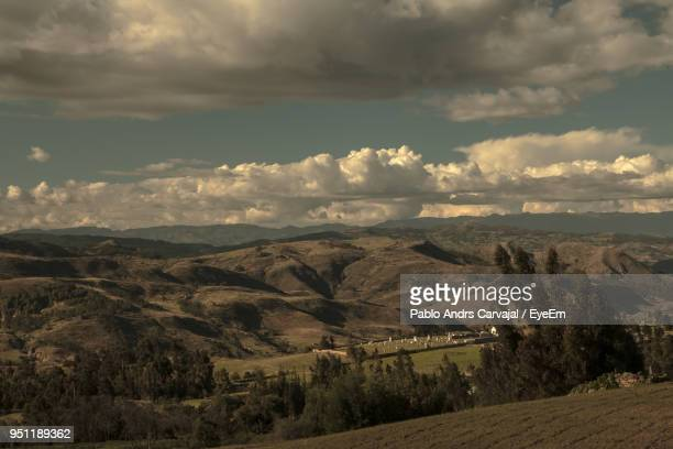 scenic view of mountains against cloudy sky - carvajal stock photos and pictures