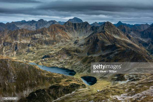 scenic view of mountains against cloudy sky,schladminger tauern,schladming,austria - andy dauer stock pictures, royalty-free photos & images