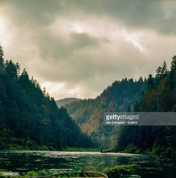 scenic view of mountains against dramatic sky - forrest compton stock pictures, royalty-free photos & images