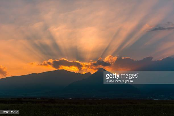Scenic View Of Mountains Against Dramatic Sky