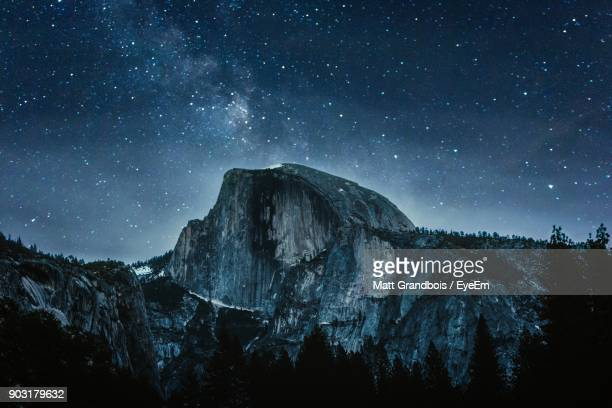 scenic view of mountains against sky at night - yosemite nationalpark stock pictures, royalty-free photos & images