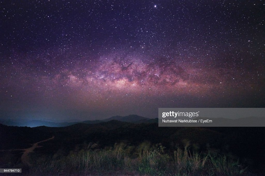 Scenic View Of Mountains Against Sky At Night : Stock Photo