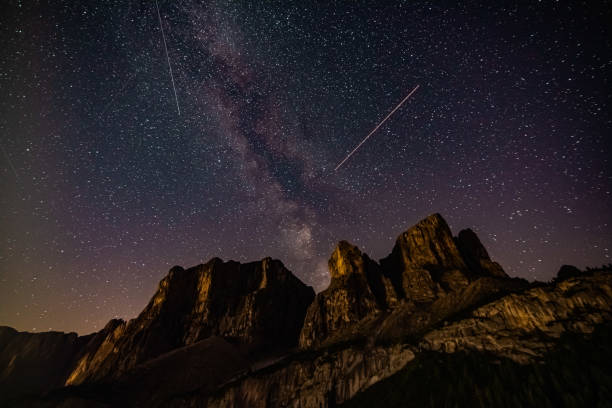 Scenic view of mountains against sky at night,Passo Gardena,Selva di Val Gardena,Bolzano,Italy