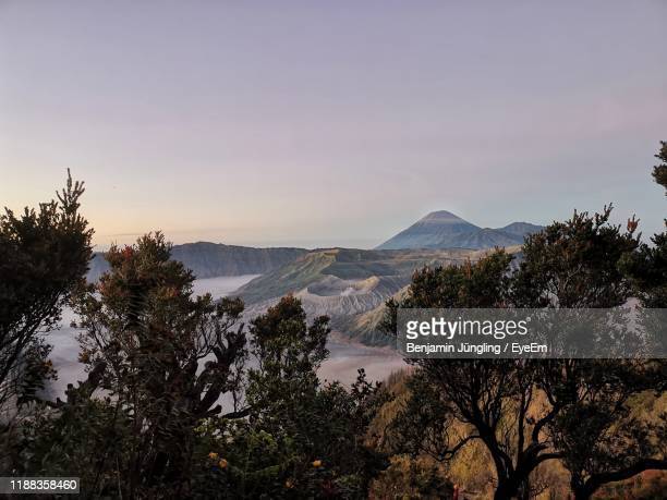 scenic view of mountains against sky at sunset - tengger stock pictures, royalty-free photos & images