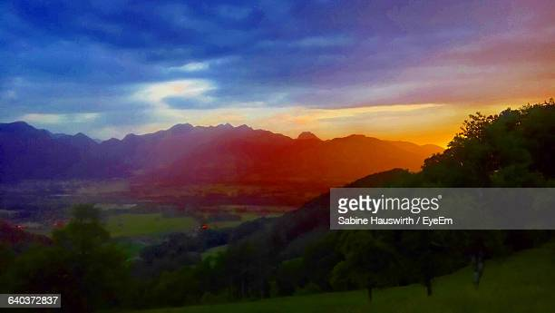 scenic view of mountains against sky at sunset - sabine hauswirth stock pictures, royalty-free photos & images