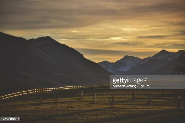 scenic view of mountains against sky at sunset - anfang stock pictures, royalty-free photos & images