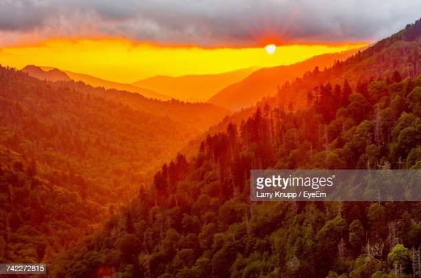 scenic view of mountains against sky at sunset - pigeon forge stock pictures, royalty-free photos & images