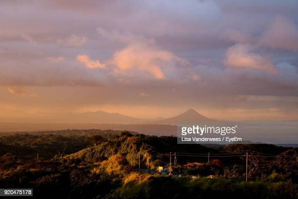 scenic view of mountains against sky at sunset - managua stock pictures, royalty-free photos & images
