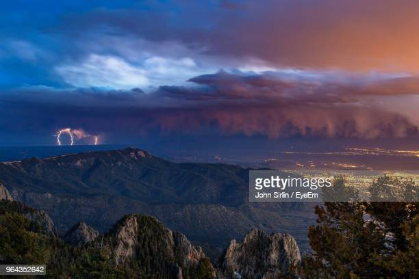 scenic view of mountains against sky at sunset - sandia mountains stock pictures, royalty-free photos & images