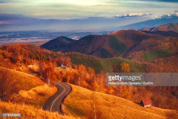 scenic view of mountains against sky during autumn - sibiu stock photos and pictures