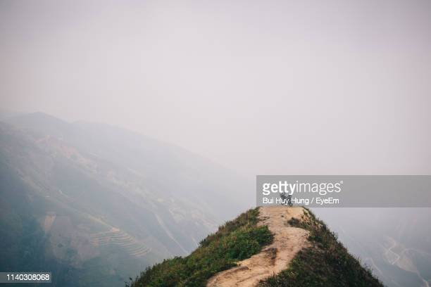 scenic view of mountains against sky during foggy weather - son la stock pictures, royalty-free photos & images