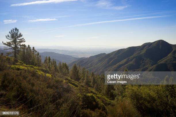 scenic view of mountains against sky during sunny day - big bear lake stock pictures, royalty-free photos & images