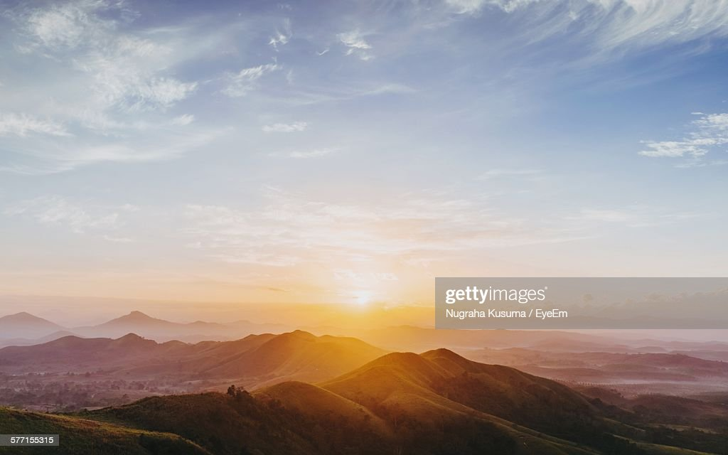 Scenic View Of Mountains Against Sky During Sunrise : Stock Photo