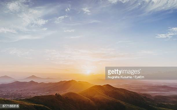 scenic view of mountains against sky during sunrise - lever du soleil photos et images de collection