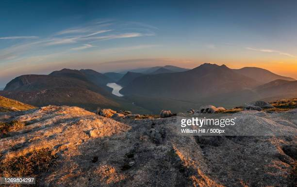 scenic view of mountains against sky during sunset, newcastle, united kingdom - newcastle united pictures stock pictures, royalty-free photos & images