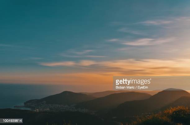 scenic view of mountains against sky during sunset - boban stock pictures, royalty-free photos & images