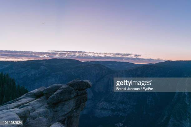 scenic view of mountains against sky during sunset - brandi johnson stock pictures, royalty-free photos & images