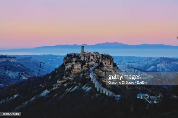scenic view of mountains against sky during sunset - civita di bagnoregio foto e immagini stock