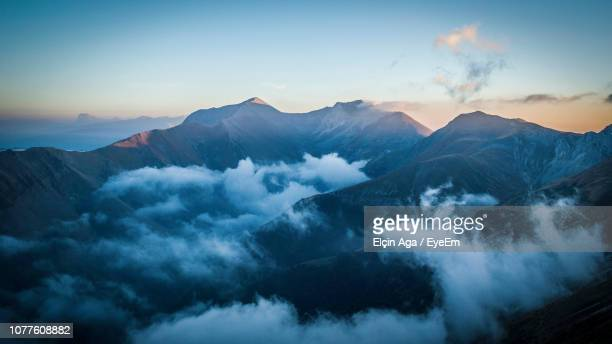 scenic view of mountains against sky during sunset - コーカサス ストックフォトと画像