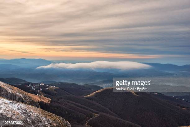 scenic view of mountains against sky during sunset - andrea rizzi stock pictures, royalty-free photos & images