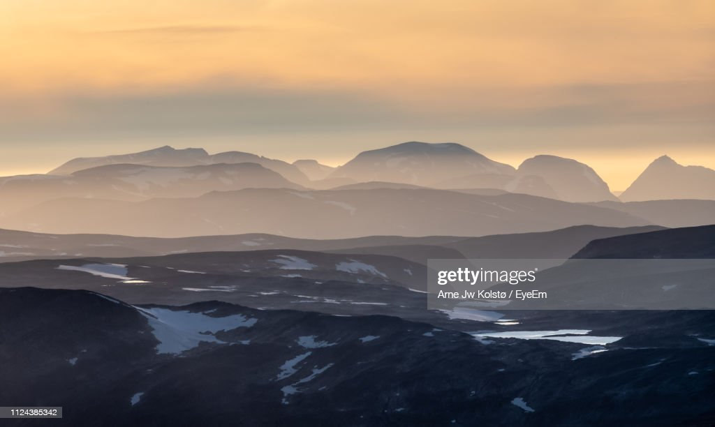 Scenic View Of Mountains Against Sky During Sunset : Stock Photo