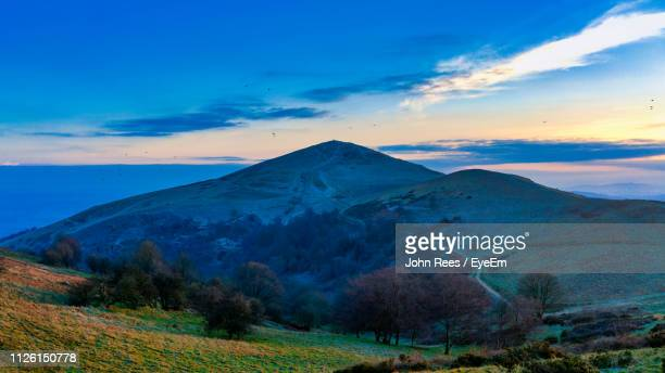 scenic view of mountains against sky during sunset - worcestershire stock photos and pictures