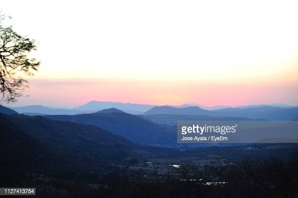 scenic view of mountains against sky during sunset - jose ayala stock pictures, royalty-free photos & images