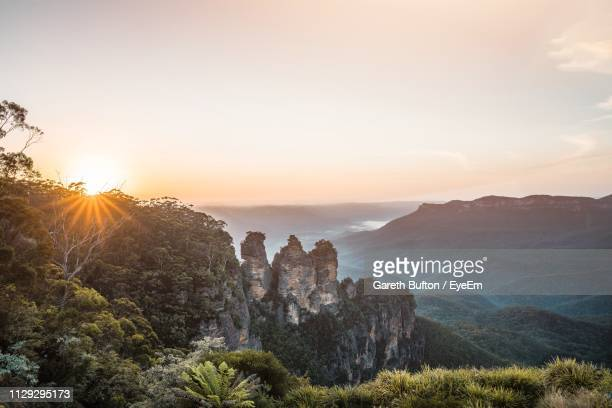 scenic view of mountains against sky during sunset - katoomba stock pictures, royalty-free photos & images