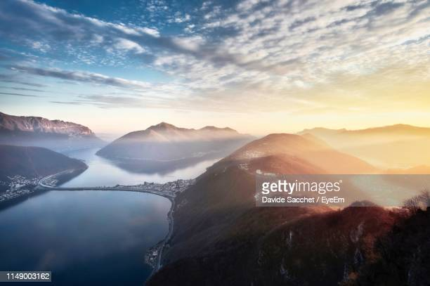 scenic view of mountains against sky during sunset - スイス ルガーノ ストックフォトと画像