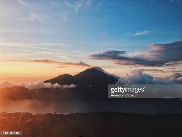 scenic view of mountains against sky during sunset - kintamani district stock pictures, royalty-free photos & images