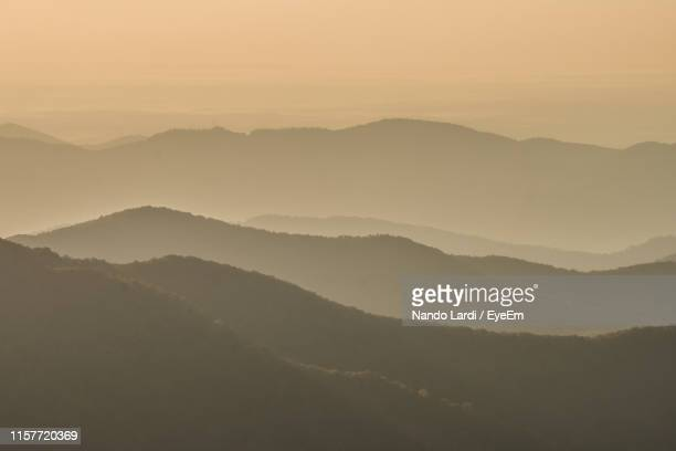 scenic view of mountains against sky during sunset - asheville stock pictures, royalty-free photos & images