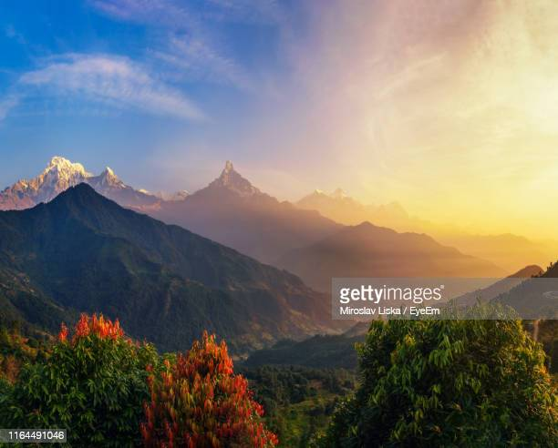 scenic view of mountains against sky during sunset - pokhara stock pictures, royalty-free photos & images