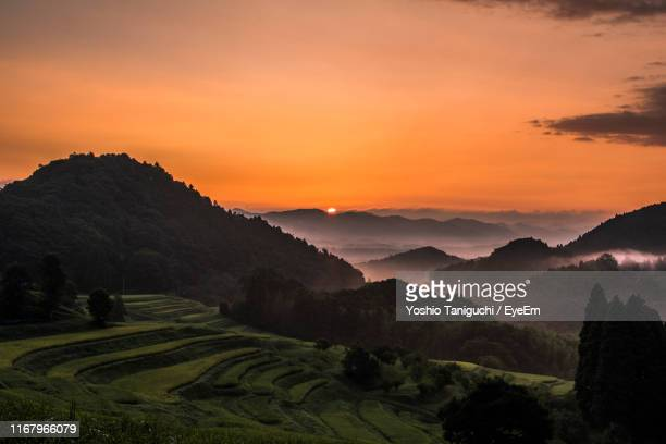 scenic view of mountains against sky during sunset - chiba city stock pictures, royalty-free photos & images