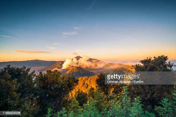 scenic view of mountains against sky during sunset - bromo tengger semeru national park stock pictures, royalty-free photos & images