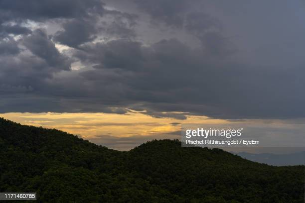 scenic view of mountains against sky during sunset - phichet ritthiruangdet stock photos and pictures