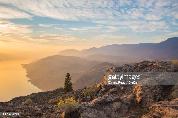scenic view of mountains against sky during sunset - kamloops stock pictures, royalty-free photos & images
