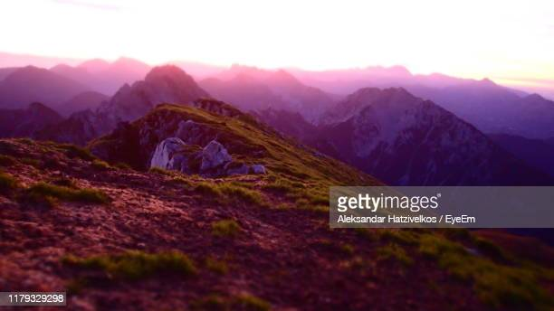 scenic view of mountains against sky during sunset - kranj stock pictures, royalty-free photos & images