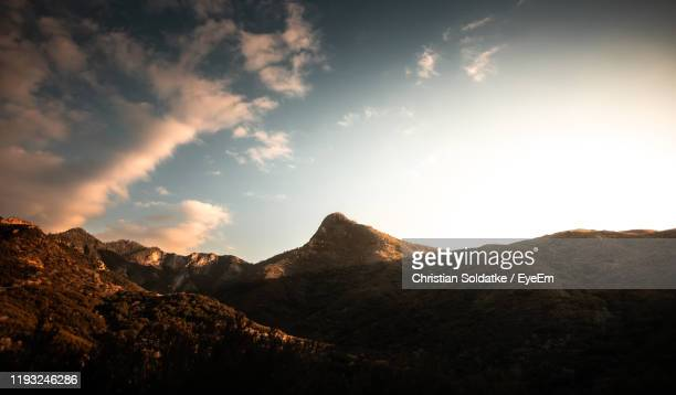 scenic view of mountains against sky during sunset - christian soldatke foto e immagini stock