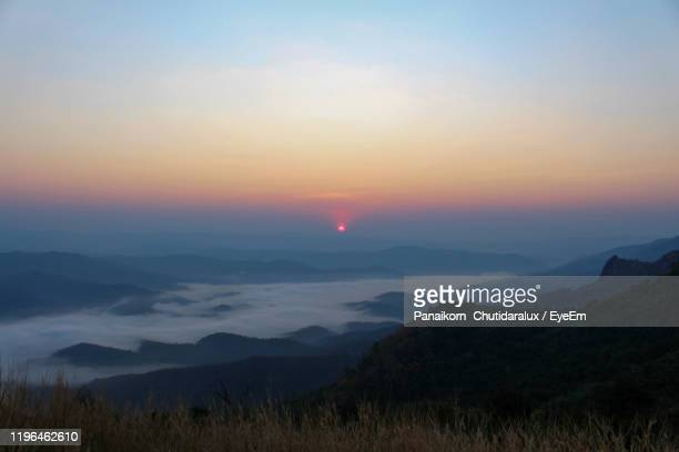 scenic view of mountains against sky during sunset - panaikorn chutidaralux stock photos and pictures