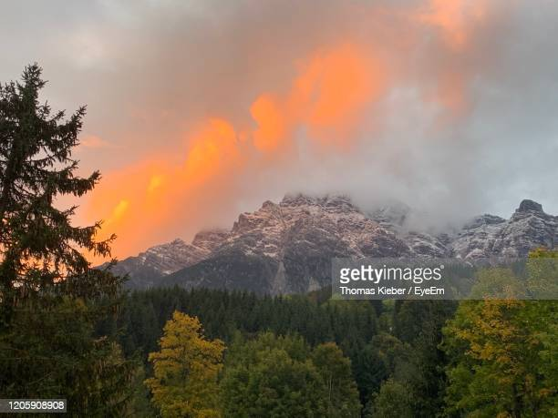 scenic view of mountains against sky during sunset - leogang stock pictures, royalty-free photos & images