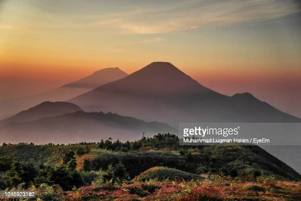 scenic view of mountains against sky during sunset - volcanic landscape stock pictures, royalty-free photos & images