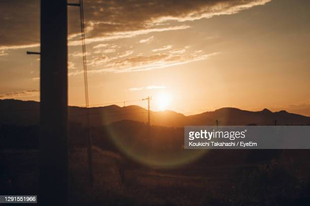 scenic view of mountains against sky during sunset - koukichi stock pictures, royalty-free photos & images