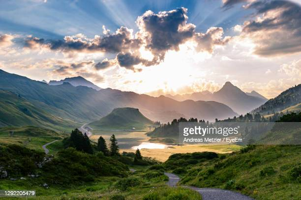 scenic view of mountains against sky during sunset - austria stock pictures, royalty-free photos & images