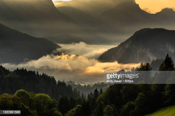 scenic view of mountains against sky during sunset - andy dauer stock pictures, royalty-free photos & images