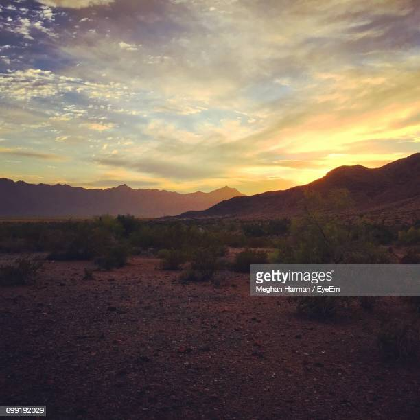 scenic view of mountains against sky during sunset - meghan stock photos and pictures
