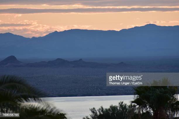 scenic view of mountains against sky during sunset - lake havasu stock photos and pictures