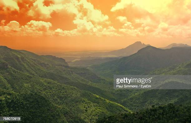 scenic view of mountains against sky during sunset - port louis stock photos and pictures