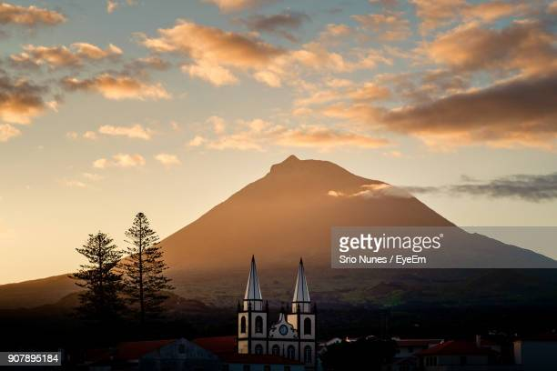 scenic view of mountains against sky during sunset - azores stock photos and pictures